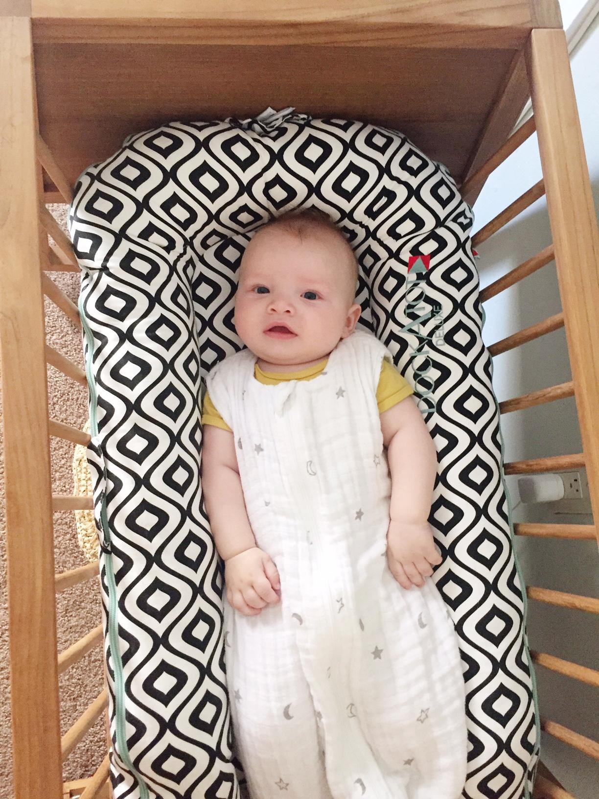 baby with sleepsack and dockatot