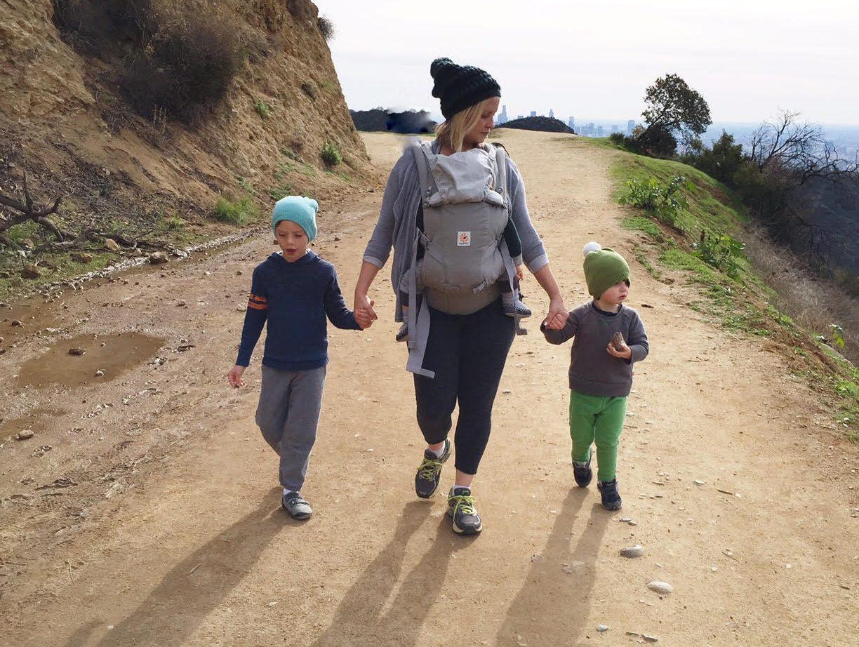 ergobaby wearing mom with three kids